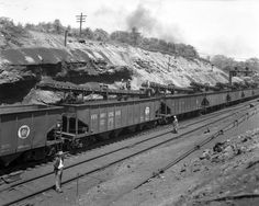 View of a Pennsylvania Railroad (P.R.R.) train being loaded with coal at a coal yard in Cambria County (circa 1924-1950).