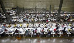 Labourers work at a large garment factory