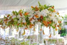 Karen Tran Flowers - Elevated flower centerpieces with green white and orange, flowers- would be lovely for a special St Patrick's day celebration. Tropical Centerpieces, White Centerpiece, Flower Centerpieces, Wedding Centerpieces, Wedding Bouquets, Wedding Decorations, Wedding Ideas, Elegant Centerpieces, Table Centerpieces