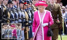 The Queen wears a fuchsia ensemble as she meets Berkhamsted School children