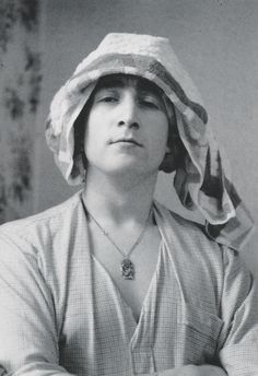 John Lennon sexy in a tea towel. How many blokes could make that claim?