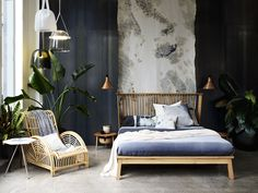 Bedroom with Mona pendant lights by BROKIS, the Companions Bed by STUDIOILSE, and Acrobates Conic Copper lights by DCW  EDITIONS
