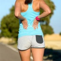 Photo about Female runner athlete low back injury and pain. Woman suffering from painful lumbago while running in rural road. Image of lesion, jogger, health - 33539834 Muscle Spasms, Muscle Pain, How To Massage Yourself, Condition Physique, Lower Back Muscles, Back Pain Exercises, Foot Exercises, Dumbbell Exercises, Back Injury