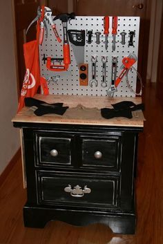 DIY work bench made from an old end table - this one's for kids, but I think an adult version would be awesome