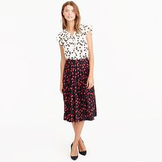 """The secret to this flattering skirt? Its sunburst-style pleats, which lie flat at the waist for a clean, streamlined effect. We crafted this version in a playful cherry print that we developed in-house and sprinkled throughout our women's collection. A couple things we like about it: the sophisticated colors and the fact that, from far away, it kinda looks like a fun polka dot. <ul><li>Sits at waist.</li><li>25 1/4"""" long.</li><li>Falls below knee.</li><li>Poly.</li><li>Back…"""