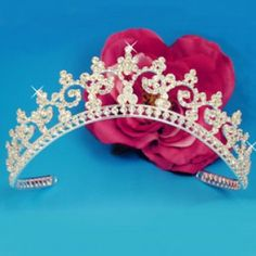 This tiara features an elegant pattern of silver plated vines and rhinestones. Delicate and sweet, it is the perfec...Price - $59.50