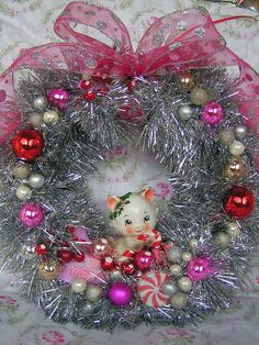 Squeal-worthy cuteness abound on this adorable, kitschy vintage Christmas ornament filled wreath