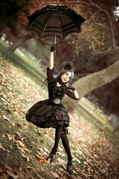 Mary Poppins!  This is an excellent picture for many reasons.  Must have taken a very skilled photographer and model.