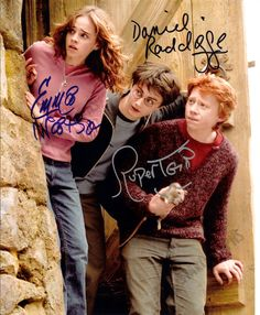 An awesome 8 x 10 inch photo signed by Daniel Radcliffe, Emma Watson & Rubert Grint from Harry Potter get your copy today Harry Potter Autographed Photo (Ref: 528)
