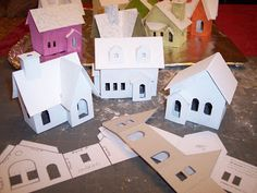 Little paper houses for a Christmas village. A good way to make an inexpensive Christmas village, and you can customize them how you want!