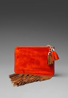 Boho-chic clutch with fringe, tassels and a beautiful orange tan by Jeffrey Campbell