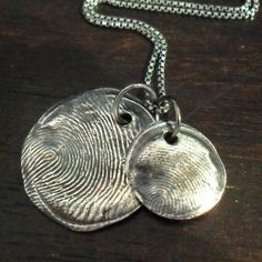 Fingerprint pendants.... so sweet.  I want this!