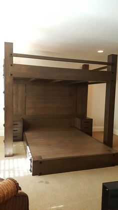 Custom Full XL loft bed over queen platform bed. Features paneled back wall and integrated night stands.   Made of rustic alder with a custom driftwood finish.