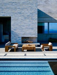 #outdoor fireplace with pool