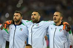 (L to R) Andrea Barzagli, Salvatore Sirigu and Leonardo Bonucci of Italy line up for the national anthem prior to the UEFA EURO 2016 Group E match between Italy and Republic of Ireland at Stade Pierre-Mauroy on June 22, 2016 in Lille, France.