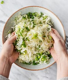 Okonomiyaki - or Japanese savory pancakes - are SO delicious and easy to make! This vegetarian recipe uses basic ingredients and comes together in under 30 minutes. Load it up with your favorite toppings, and enjoy! | Love and Lemons #vegetarian #japanesefood #okonomiyaki #cabbage
