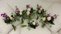 Bridesmaids bouquets with white O'Hara  garden roses and fuchsia  Dendrobium Orchids