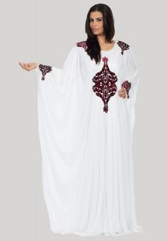 Haya's Closet  Long draped jalabeya with black lacelike detail on front and back  So feminine, so pretty! This marvelous Jalabeya from Haya's Closet will give you a look worth a million dollars. We love the flowy cut, graceful color and the sleek contrast embroidery on shoulders, sleeves and overlay.  Size guide