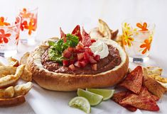 Mexican Fiesta Cob Dip Give nachos the flick! This easy bean-filled cob loaf will easily feed the masses. If you're looking for a cob recipe, this one will definitely impress. Cob Dip, Cobb Loaf, Mexican Food Recipes, Ethnic Recipes, Loaf Recipes, Appetisers, Easter Recipes, Nachos, Food Truck