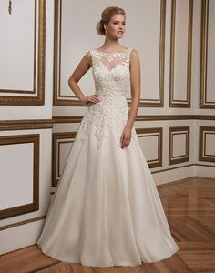 Justin Alexander wedding dresses style 8835  Lace adorns the Sabrina illusion neckline and fitted bodice of this organza A-line gown that is figure flattering and sophisticated.