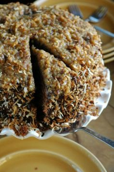 Toasted Coconut German Chocolate Cake Recipe ~ The Adventure Bite. Toasting coconut has seriously changed my entire opinion of the stuff!