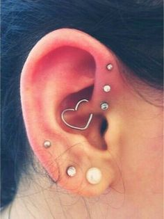 I rather like the third, upper lobe piercing. Think I might get this done soon...Update; got my upper most part of lobe pierced yesterday 9/3/16 and I love it .