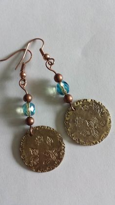 Hammered and stamped mixed metal copper and bronze dangle earrings.