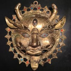 Vintage Tibetan Kirtimukha brass deity mask with turquoise and coral $110