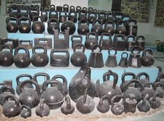Evolution of a kettlebell. Old school kettlebells from 1800's to more recent models. Big kettlebell in the middle is 117kg (257lb). Note different shapes - Russians started making round kettlebells after order of Pavel I (18th century) since kettlebells with edges got obliterated and eroded much faster than round counterparts. photo credit: Oleg Moroz