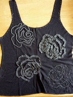 So THAT'S how to sew a detailed pattern! I love the reverse-applique version on the bottom-right :) Kristina's rose - sampler of Alabama Chanin techniques by M lambie, via Flickr