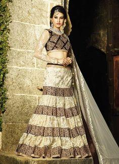 Dazzling Cream With Wine Heavy Embroidered Bridal Lehenga Choli http://www.angelnx.com/Lehenga-Choli