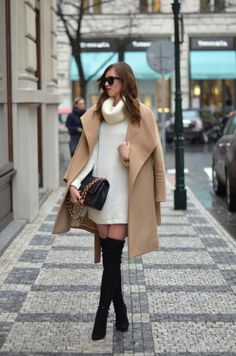 The camel trend will make a stellar match to a pair of black thigh high boots, as shown here in this gorgeous combination by Barbora Ondrackova consisting of a cream sweater dress and an oversized camel coat. Dress: Topshop, Coat: Mango coat, Boots: Stuart Weitzman, Bag: Chanel.
