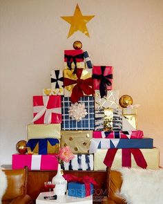 DIY Christmas tree made out of presents. A fun way to display gifts as a decoration.