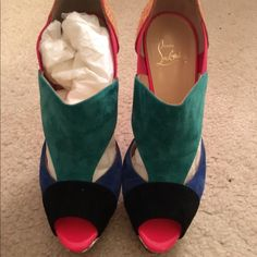 Authentic Christian Louboutin booties Multi color sued with Python excellent condition only wore 3x comes with original box and dust bags Christian Louboutin Shoes Ankle Boots & Booties