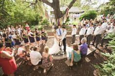 Ceremony. Rug to stand on at the top of the alter creates a central focal point. Great for an outdoor ceremony.