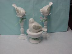 repurposed ~ make some TINY candlestick pedestals and perch little fuzzy blue birdies on them :o)