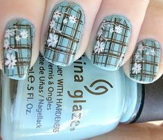 Plaid Nails with Flowers.  Too cute, but I could never do this. Not good enough at painting my own nails