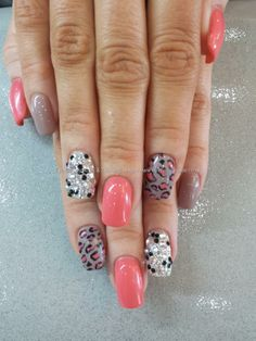 Ocean coral and nude gel polish with freehand nail art and swarovski crystals