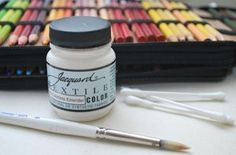 DIY How To use colored pencils to draw on fabrics, and make them permanent.  Great for adorning re-styled clothing!