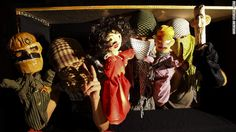"""Syrian artists fight Assad regime with satire. Pictured here is the puppet cast of """"Top Goon: Diaries of a Little Dictator,"""" produced by anonymous Syrian artists' collective Masasit Mati. At the far right is the character representing Assad, known by the diminutive """"Beeshu."""" Image courtesy Masasit Mati"""