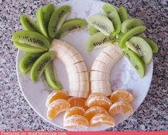 .Palm trees made out of fruit. t