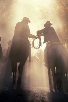 cowboys- This picture reminds me of my grandfather who got up every morning at the crack of dawn- ready to ride.