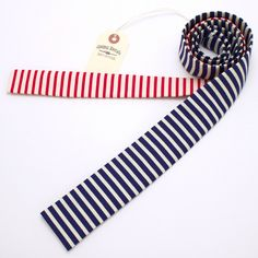 Everything old is new again! The square-end design of this limited edition tie harkens back to the height of 1980s mens style, and the combination of red and blue stripes brings a patriotic flare to any outfit. Slip on this stylish necktie made from vintage fabrics and you can't help but feel like a retro stud!