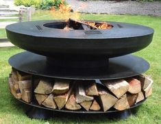 Summer style!! Wonderful modern contemporary round outdoor fireplace
