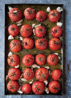 Another great appetizer recipe from SAVEUR, Roasted Tomatoes served with a warm baguette and chevre! Yummm!   #saveur #dinnerparty