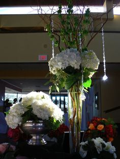 The English Florist Specializes in the Art of Wedding Design. White hydrangea , curly willow and bells of Ireland, with hanging crystals