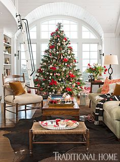 This Scotch pine goes in the living room of a 1940s stone cottage and is decorated with glass balls and other special keepsakes. - Photo: John Bessler / Design: Kim Deetjen
