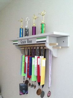 gymnastics trophy and medal shelf - Google Search