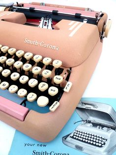 Really WANT this!! I kinda want to say I need it, but I know better!   1955 Pink Corona Typewriter with Case and by joevintage