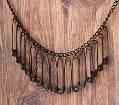 black safety pin necklace  http://www.etsy.com/listing/81380911/safety-pin-bib-necklace-in-black